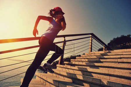 Photo for Female Runner athlete running on stairs. fitness jogging workout wellness concept. - Royalty Free Image