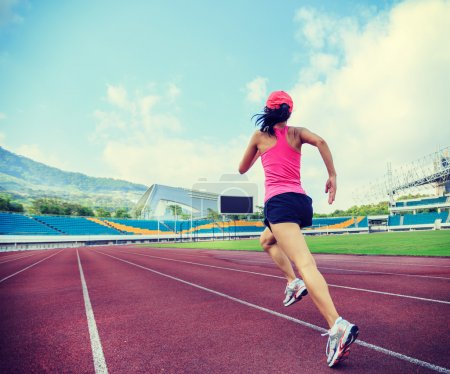 Fitness woman on stadion track