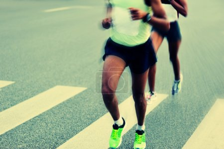 Marathon athletes running on road