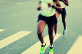 Marathon athletes running on road