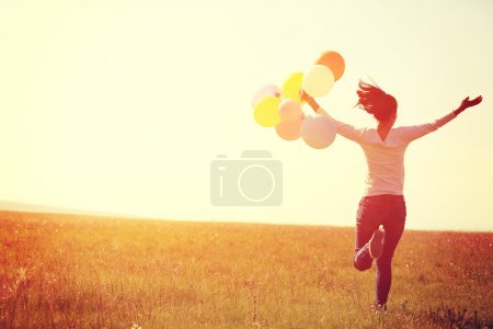 Asian woman running with balloons