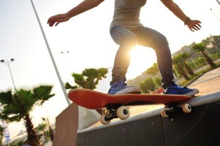Skateboarder skateboarding in park
