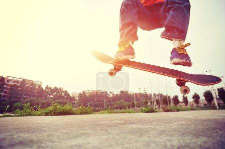 Young skateboarder skateboarding