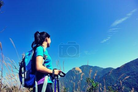 Female climber on mountain peak