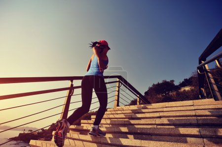 Woman running on stone stairs