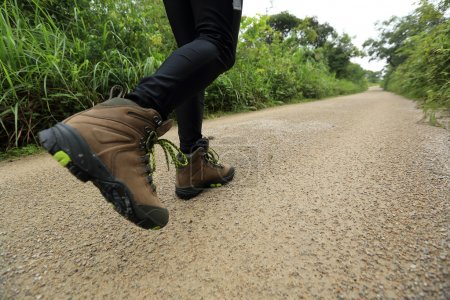 Woman hiking on trail