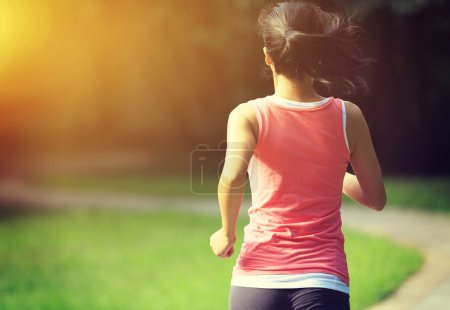 Runner athlete running at park trail