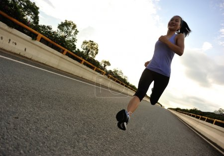 Photo for Female Runner athlete running on road - Royalty Free Image