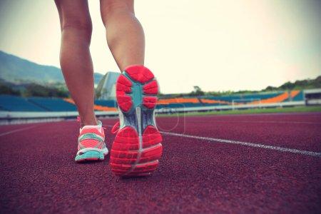 Young woman runner legs