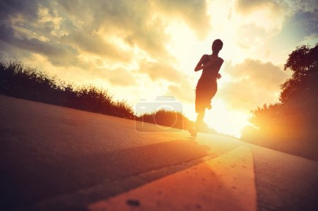 Photo for Young fitness woman runner running on sunrise trail - Royalty Free Image