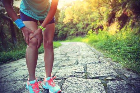 Woman runner hold  injured knee