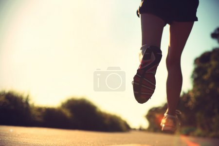 Young fitness woman legs running