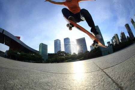 Skateboarder legs skateboarding at city