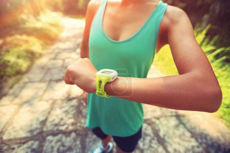 young woman jogger with smart watch