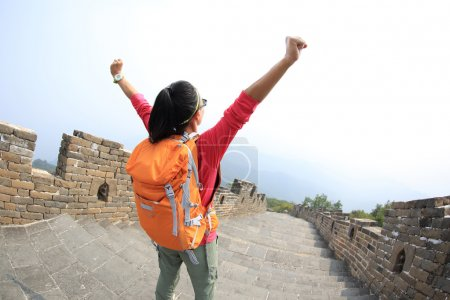 cheering woman hiker with open arms