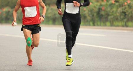 marathon runners on city road
