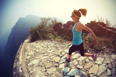 female legs running on chinese great wall