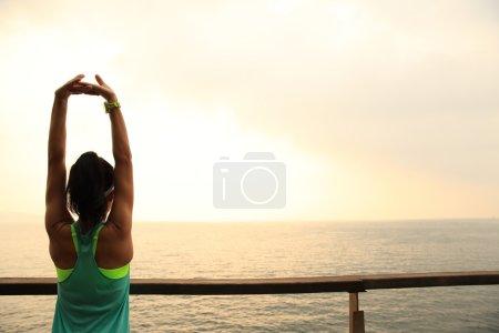 Fitness female runner stretching
