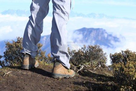hiker legs on mountain peak