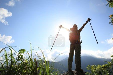 woman hiker on mountain peak