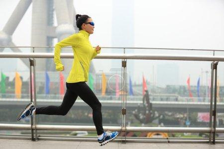 female running at shanghai city