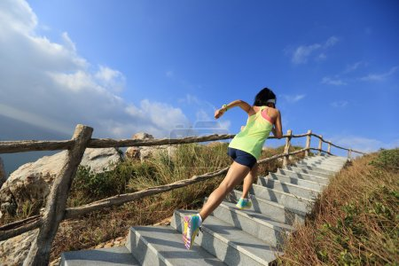 Photo for Young fitness woman running up on mountain stairs - Royalty Free Image