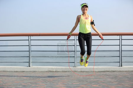 woman jumping with rope