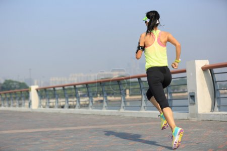 fitness woman running at seaside