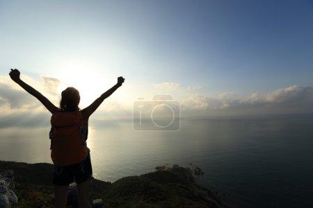 woman at mountain peak
