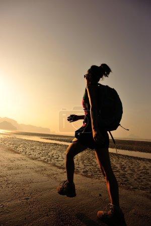 woman on sunrise beach