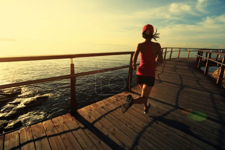 fitness woman runner on boardwalk