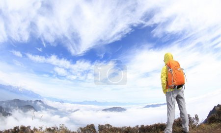 hiking woman on mountain peak
