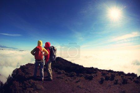 backpackers enjoying beautiful landscape