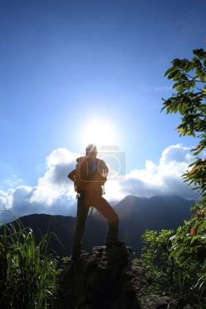 young woman at mountain peak