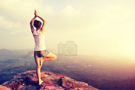 yoga woman at mountain peak