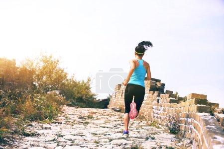 woman  running at chinese great wall