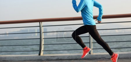 Photo for Young fitness woman runner running at seaside - Royalty Free Image