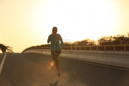 fitness woman running on road
