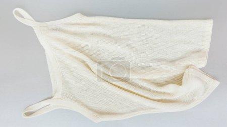 Elegant stylish white knitted sleeveless women shi...