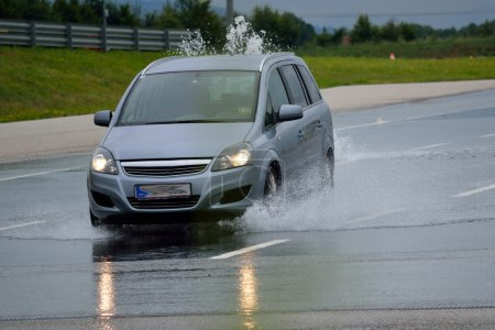 Photo for Special car-driving safety training on practice area - aquaplaning - Royalty Free Image