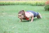 Fitness woman doing push-ups during outdoor cross training worko