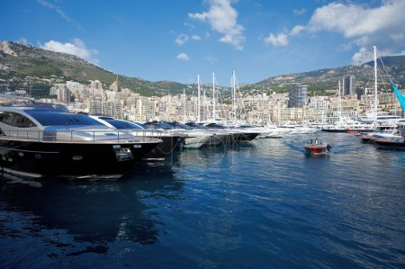 Monaco, Monte-Carlo, 29.05.2008: Port Hercule, View from water, luxury yachts in harbor of Monaco, Etats-Uni, Piscine, Hirondelle, riva boat