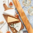 Постер, плакат: Different kinds of cheeses baguette and white wine