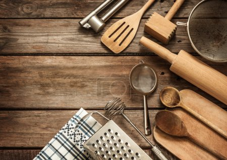 Photo for Rural kitchen utensils on vintage planked wood table from above - rustic background with free text space - Royalty Free Image