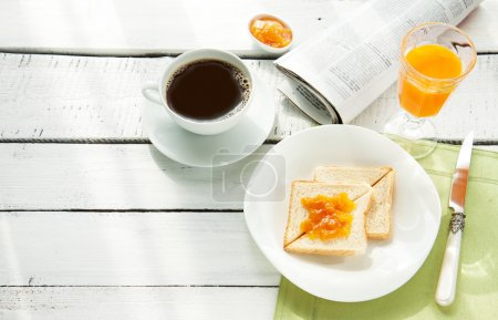 Photo for Continental breakfast - coffee, orange juice and toast on white wood table. Background with free text space. - Royalty Free Image