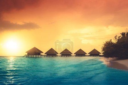 Photo for Sunset on Maldives island, water villas resort - Royalty Free Image
