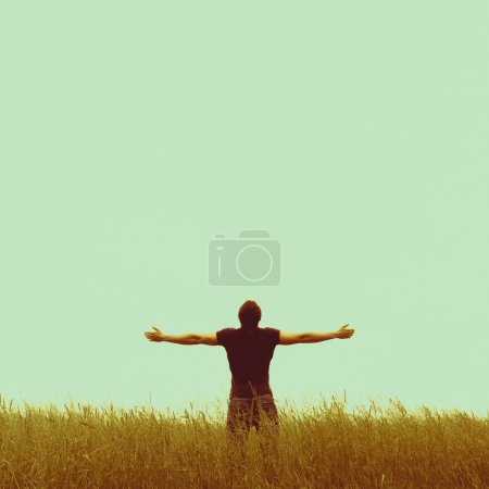 Silhouette of man standing on an empty background....