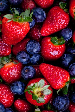 Photo for Strawberry and blueberry fruits background - Royalty Free Image