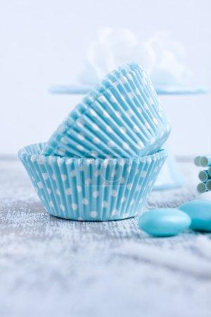 Sugar coated candies, cupcake baking cups, straws