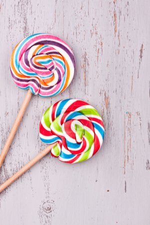 Photo for Two tasty Lollipops on a wooden background - Royalty Free Image